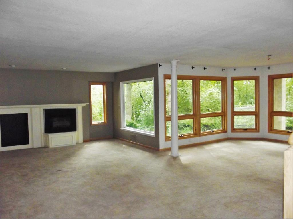 Formal dining has a gas fireplace.