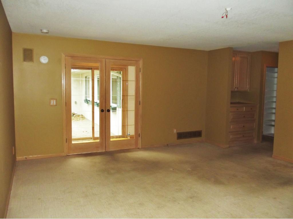 Master suite has atrium doors to hall and a view of the secluded patio.