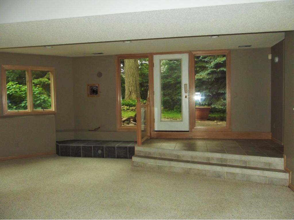 Lower level amusement room offers atrium doors to a patio with room for you to add a hot tub!