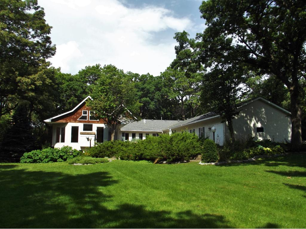 Side view of the home, highlighting expansive lawn around the home.