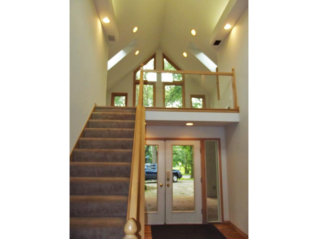 Stairs from foyer lead up to the open loft, with its views of the front yard and skylights to make this a bright, cheerful area.