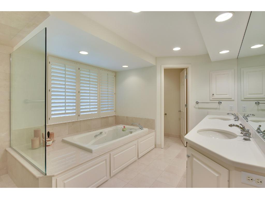 Updated master bath with double sinks, separate shower & water closet