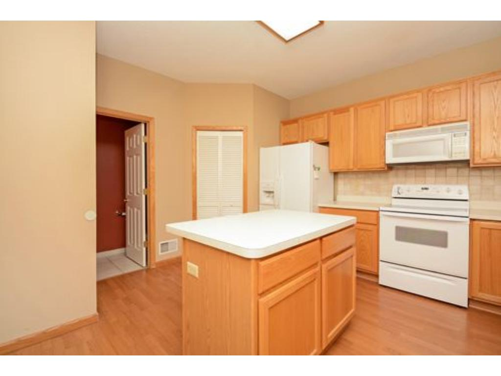 Eat in kitchen with center island storage.  All appliances stay.  Pantry closet and nearby 1/2 bath.  Next to the garage door for quick and easy unloading of groceries.