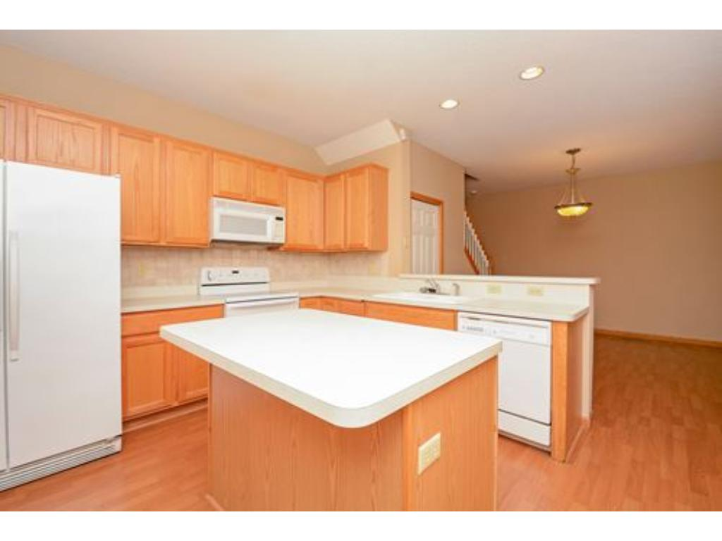 Eat at the center island, breakfast bar or dining room area.  Maintenance free flooring and lots of lighting.