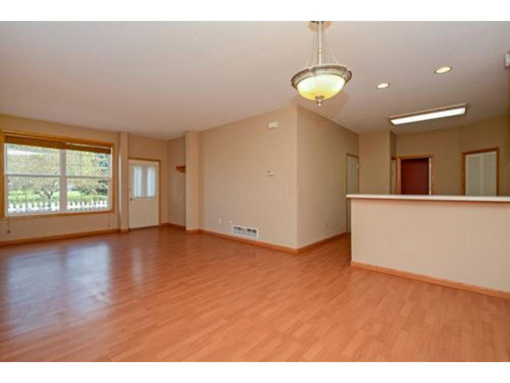 Maintenance free flooring in the living and dining room area.  With a large window facing East and the private patio.