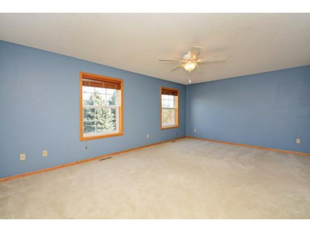 King sized master bedroom with plenty of room for the king sized bedroom set and a couch and chair.  Ceiling fans in both bedrooms.  Custom blinds on all of the windows too.  Morning sunshine!