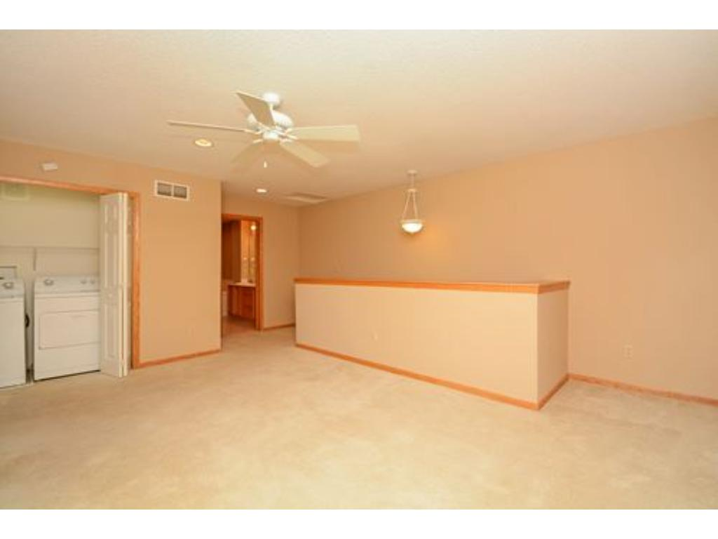 Upper loft is large enough for a ping pong table, another den area or office.  Or setup the exercise equipment. Ceiling fan and recessed lights in this area too.  Next to the laundry area.