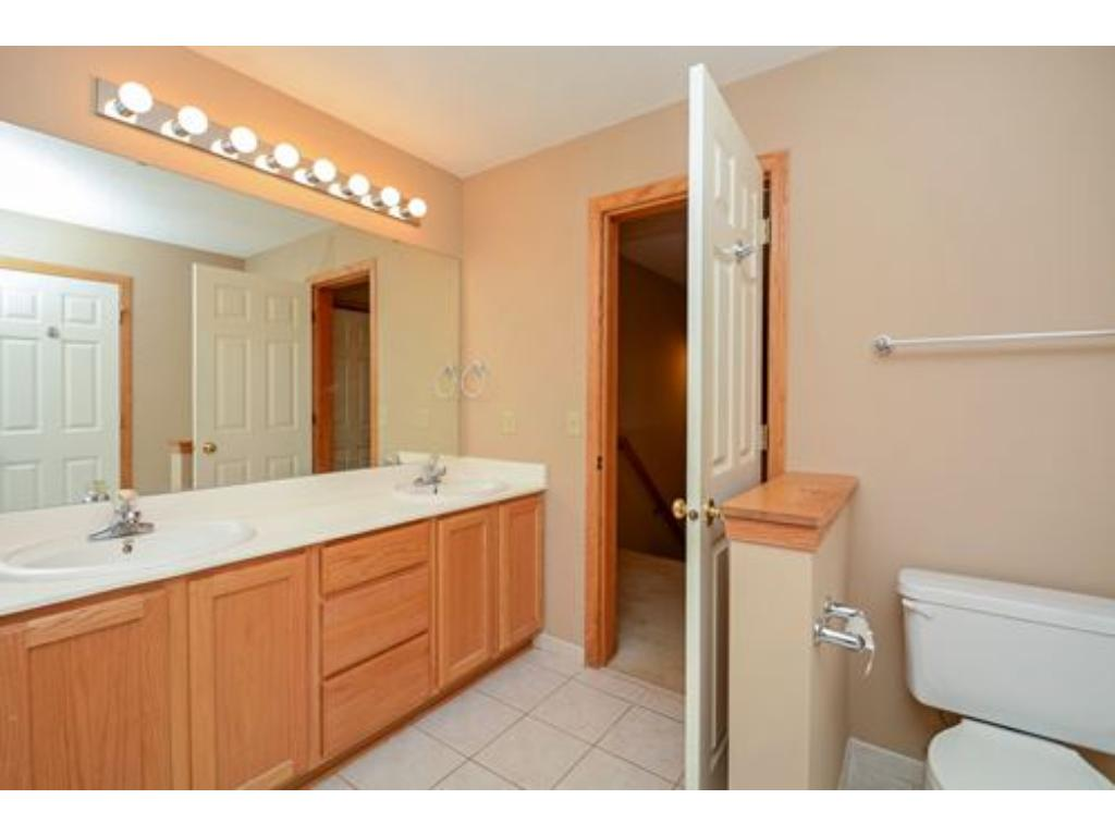 Walk through master bathroom.  Double vanity, separate tub and whirlpool tub.