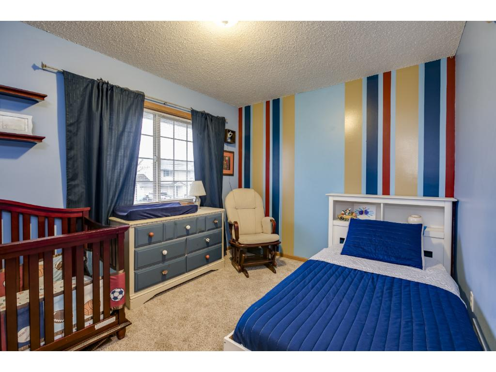 This adorable bedroom lies on the main/upper level, just adjacent to the master bedroom.