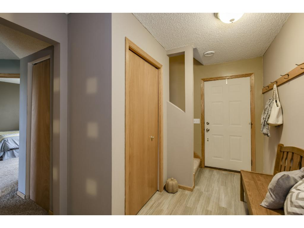 The entry to this home is spacious and has new, fun, modern tile and fresh gray paint.  The foyer is just off the garage.