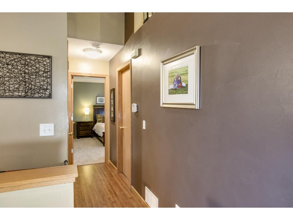 The hallway leads to the full bathroom and two bedrooms, including the master bedroom.