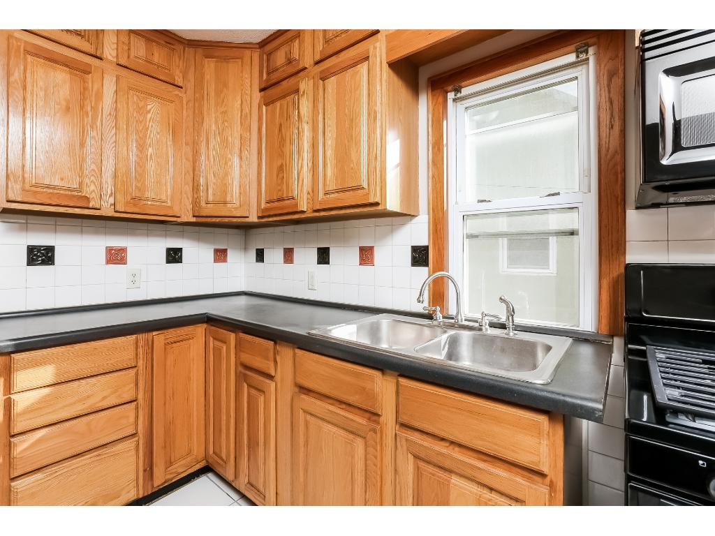 Kitchen offers newer appliances, back splash and refinished cabinets