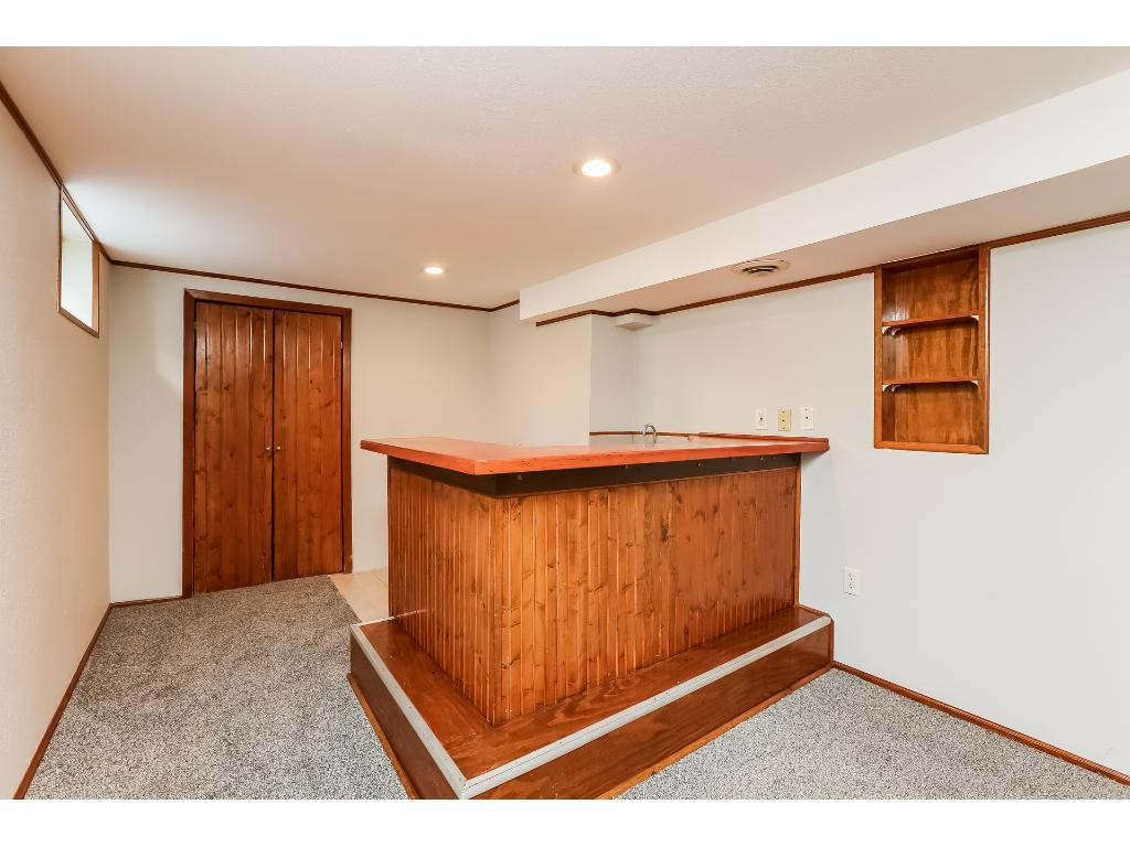 Your lower level family room doubles as a perfect rec room for entertaining.  Complete with full wet bar