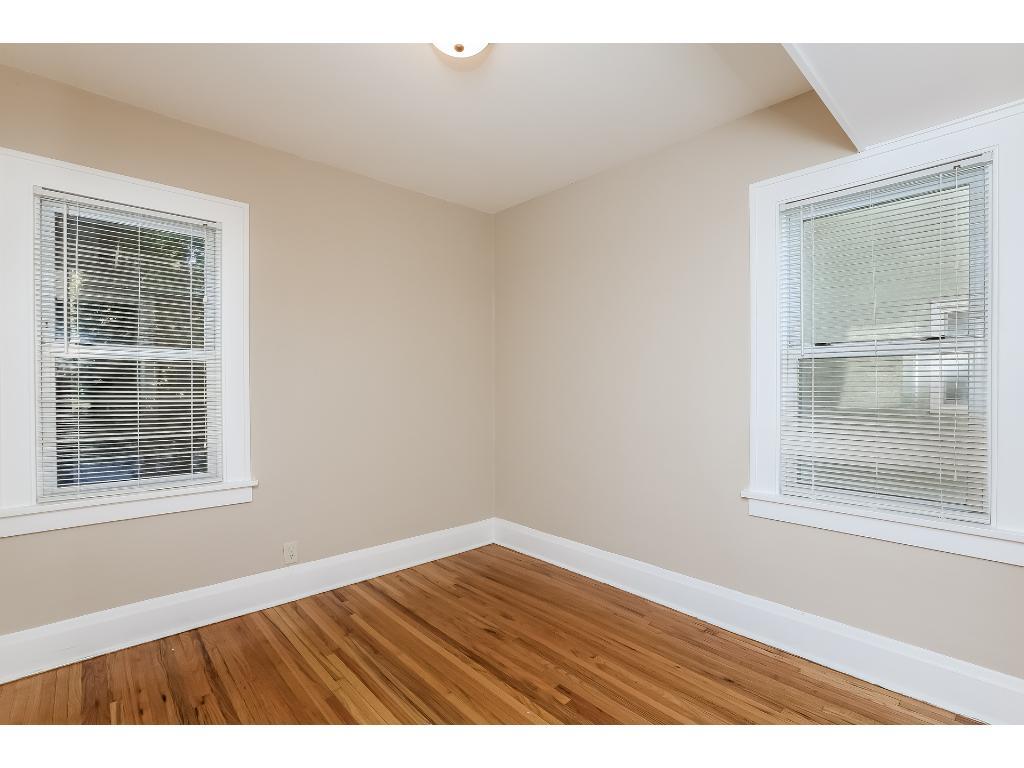Main floor bedroom #1 with newly refinished hardwood floors