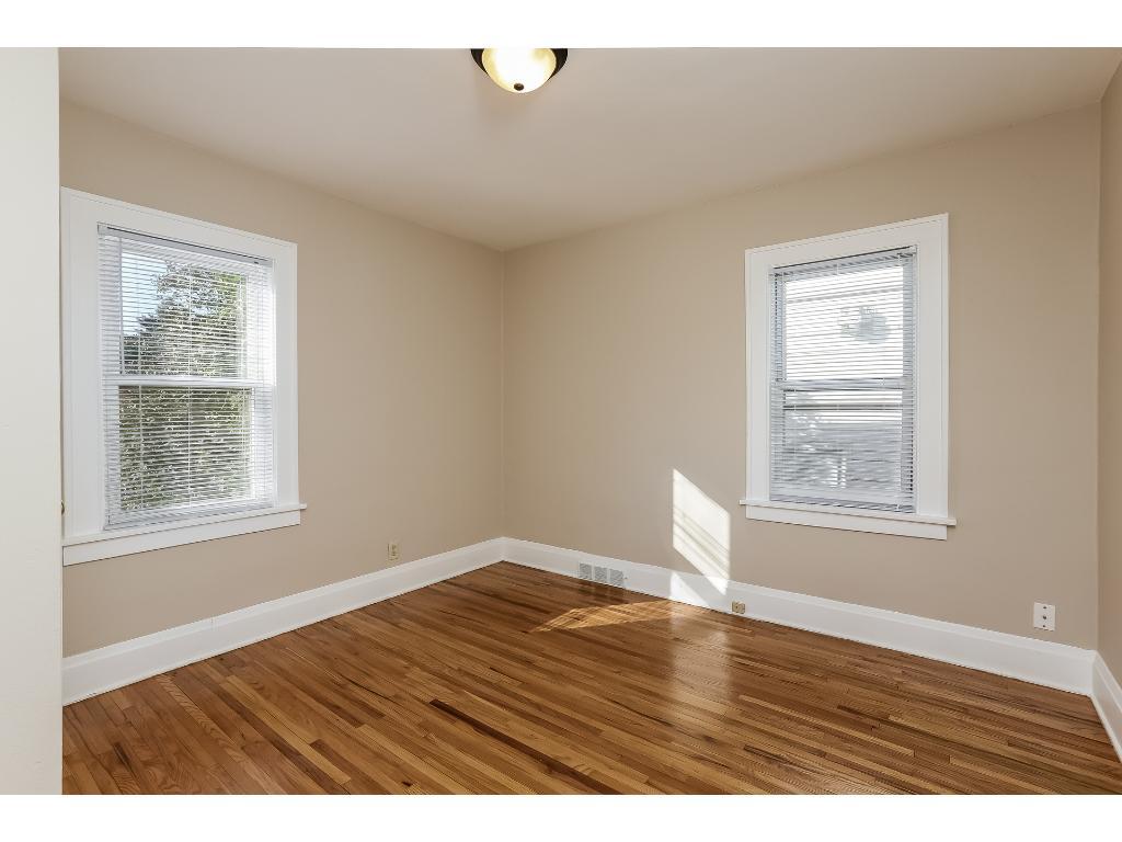 Main floor bedroom #2 with newly refinished hardwood floors