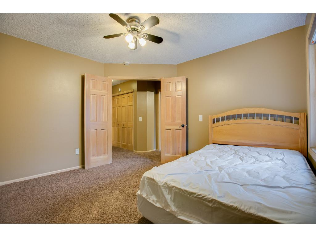 One of the spare bedrooms has charming double doors.