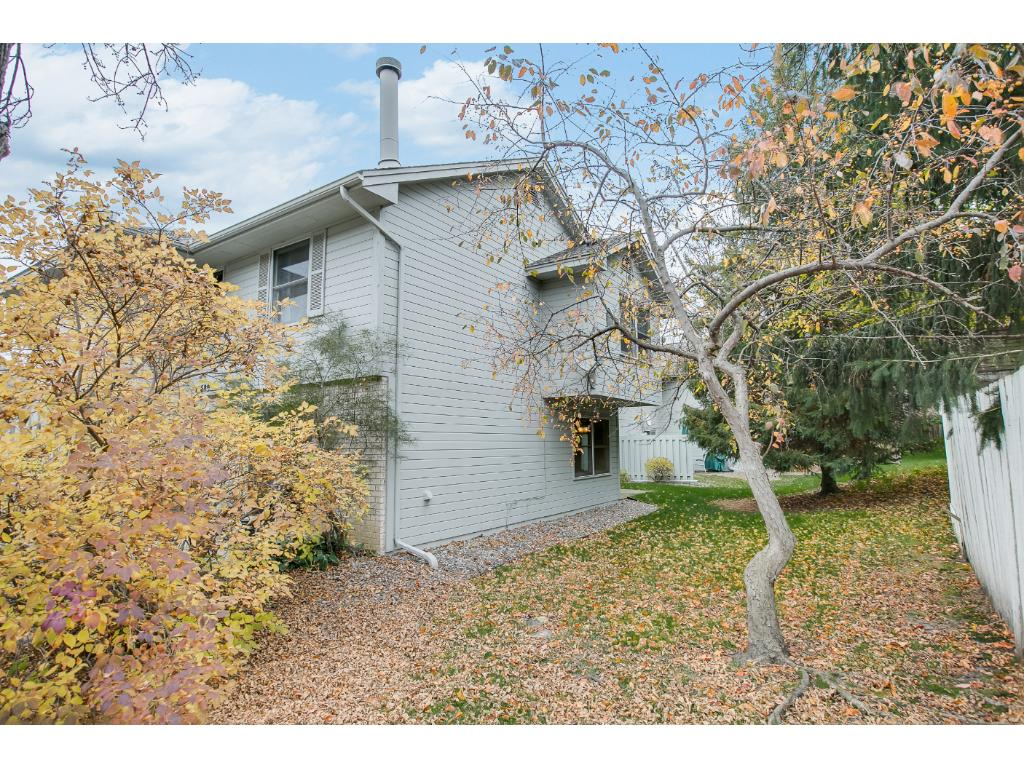 Being an end unit, you have a great side yard with trees and bushes, lots of privacy.