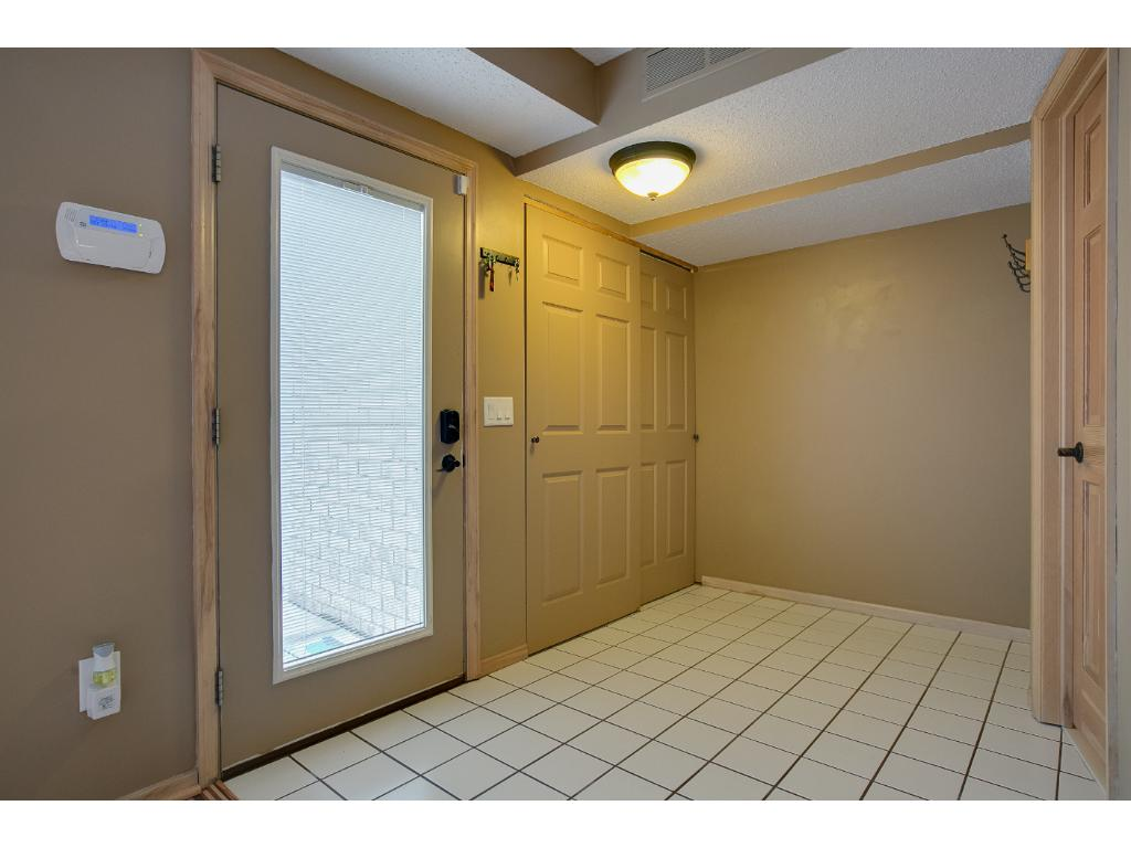 Huge foyer is accessed from the front door and the garage.