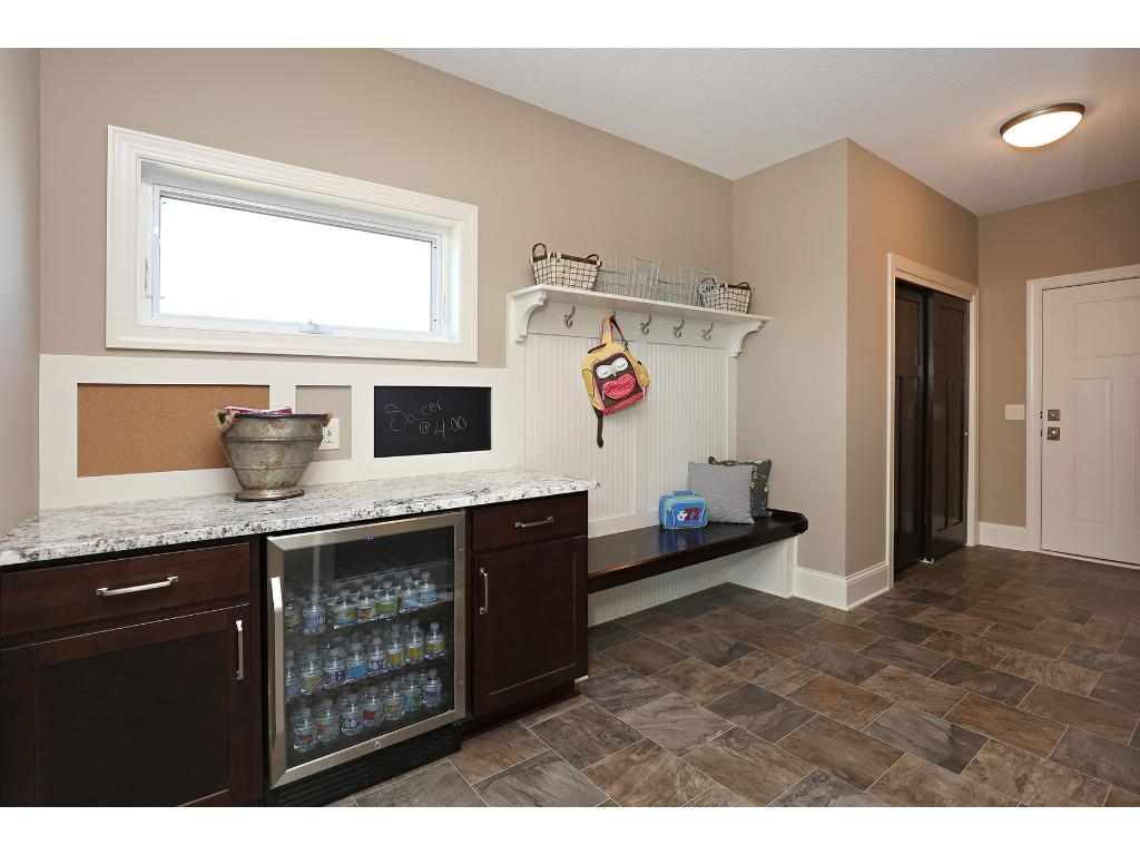 What a great mud room! Family Sized with Beverage Frig, USB Plug-In's, memo station, bench seat with hooks, large coat closet and access to oversized 3 car garage, which is extra deep for boat storage!  WOW!