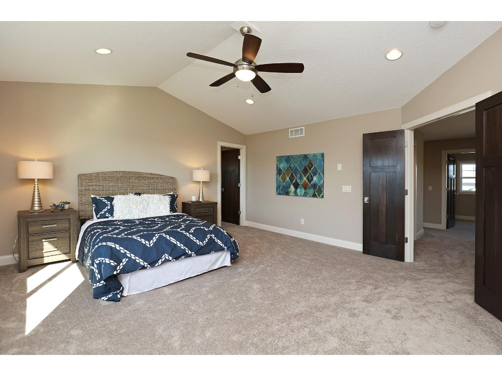 Double Doors open to Vaulted Master Suite~