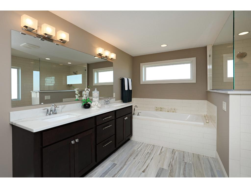 Beyond Beautiful~ This Master Bath is Sure to Impress - Designer Tiled Flooring & Walk-in Shower~ Notice how the half wall offers privacy while showering!  Incredible Details Throughout this Gorgeous Custom Home which is AVAILABLE TODAY!
