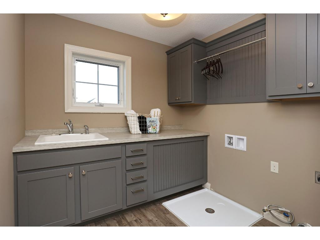 How Convenient~Upper Level Laundry Room near Bedrooms! Window for Natural Light, Custom Cabinets & Floor Drain!