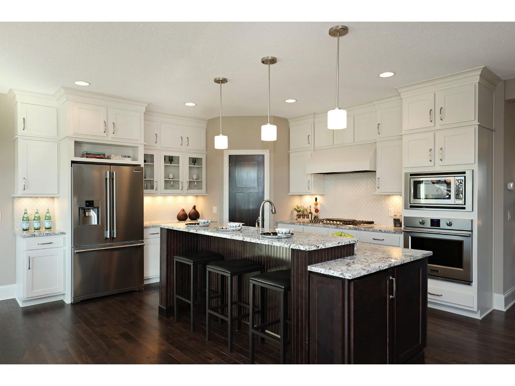 Designer finishes throughout this home including Quartz countertops and top of the line stainless appliances!