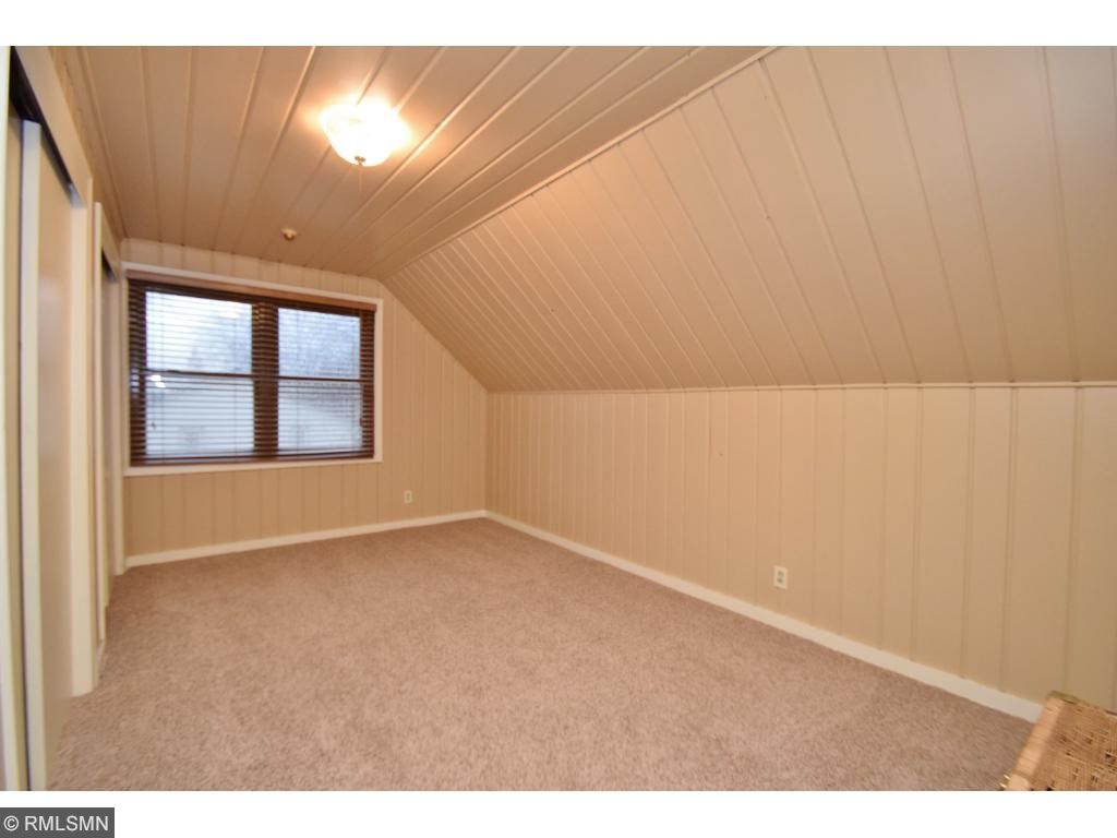 3rd bedroom, upper level, double closets and storage behind closet space.