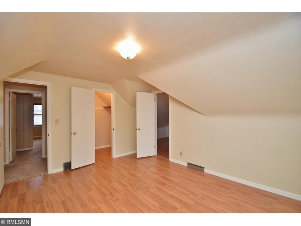 4th bedroom upper level, laminate wood flooring with 2 walk in closets.  One walk in closet could be den/office or craft room.
