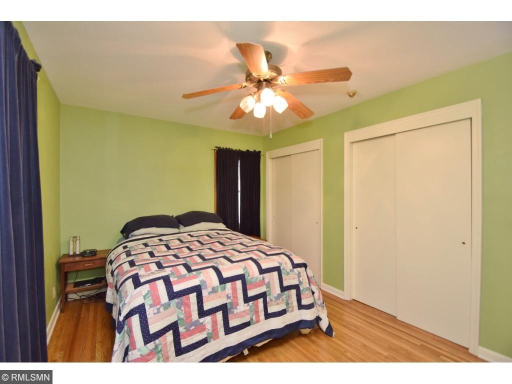 Bedroom 1 on main level, double closets, sharp hardwood floors.