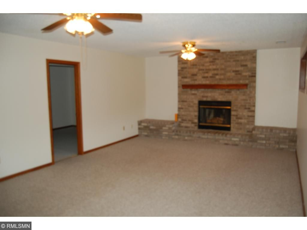 The lower level family room features a brick wood burning fireplace