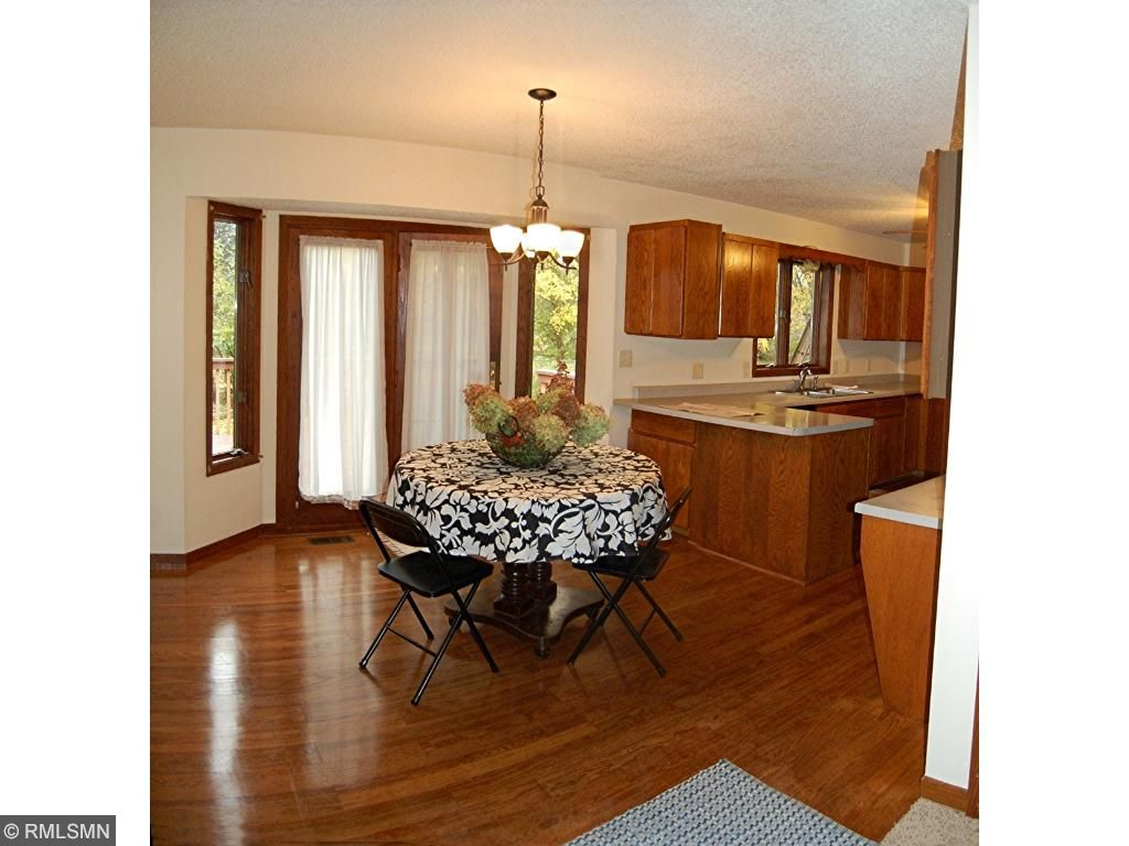 Gleaming hardwood floors and atrium door to backyard