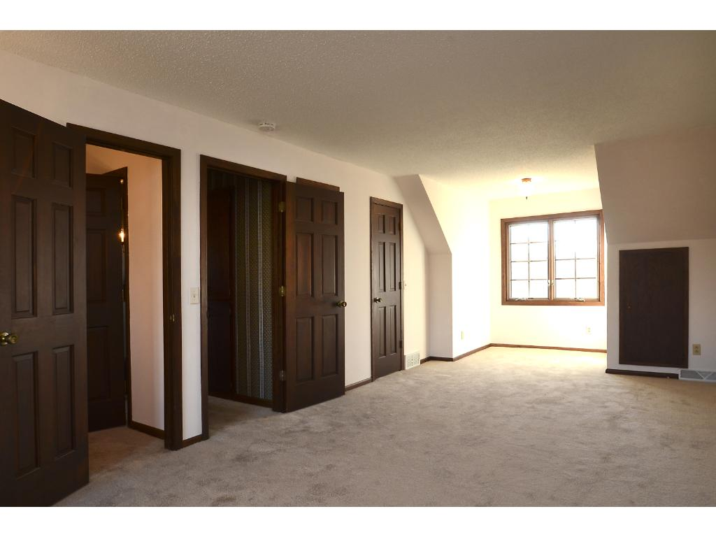 Another upstairs bedroom with large closet