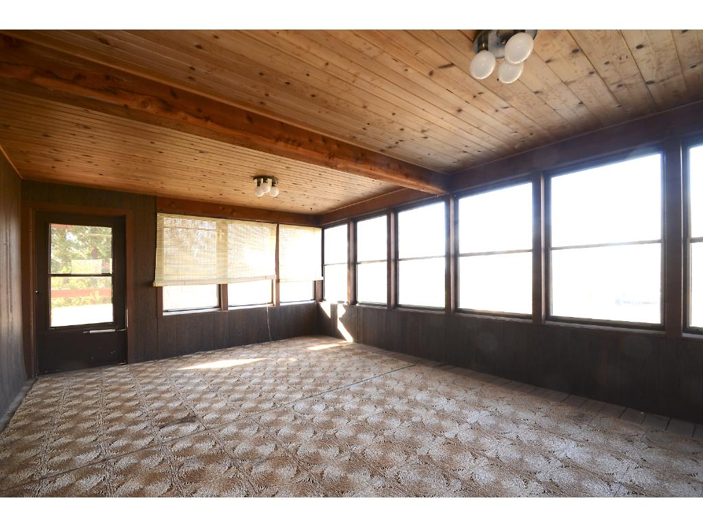 Long front porch to sit and take in the views of your lovely 2.64 acres