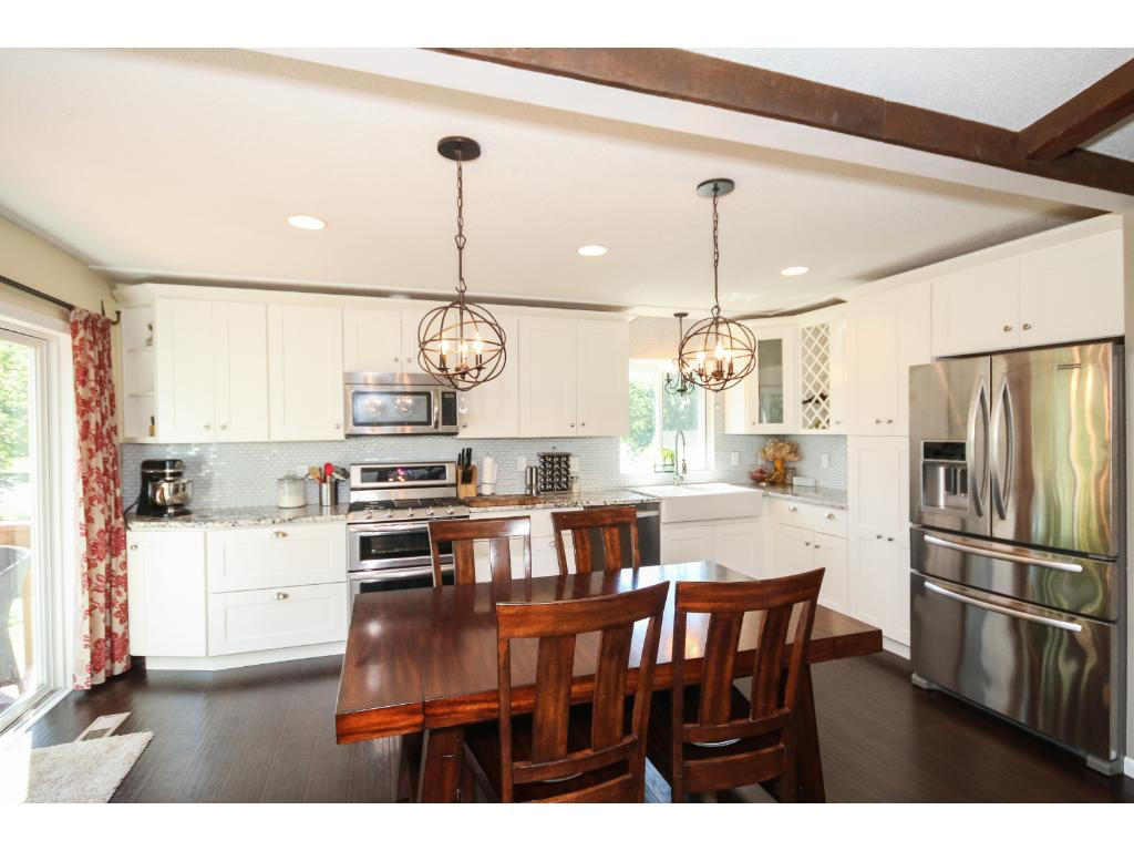 Updated Kitchen With Stainless Appliances, Granite, Wood Floors, Tile Back  Splash And More