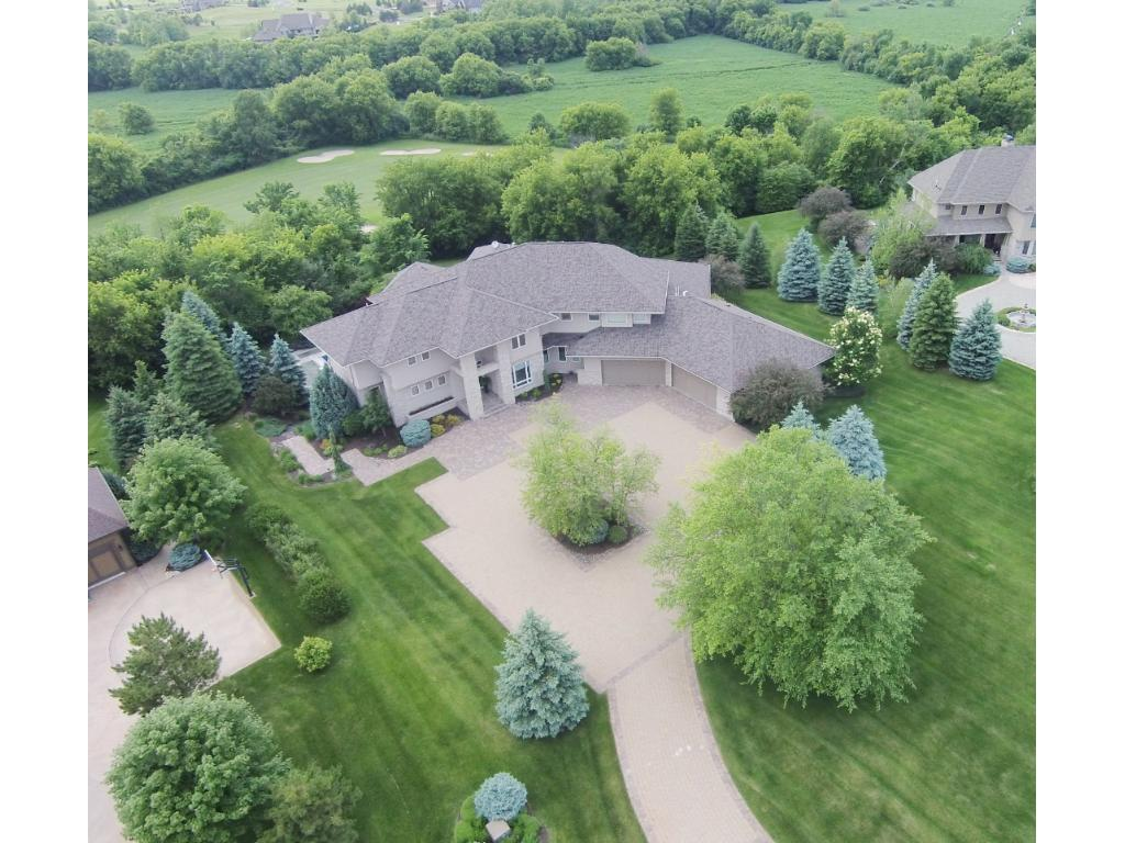 Gorgeous home situated on a private 1.78 acre lot w/ breathtaking views - Located on Legends Golf Course! Fantastic curb appeal w/ attractive landscapes & stone front. Prestigious Credit River offers peaceful country living & just 4 miles from I-35!