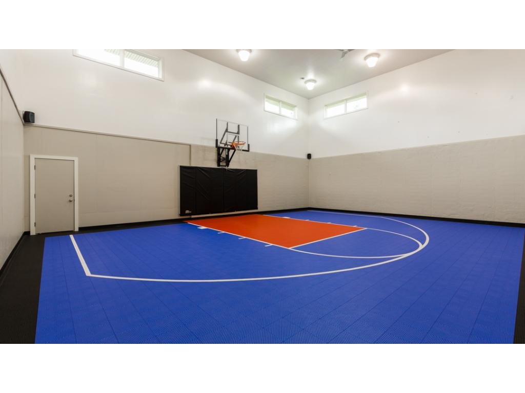 Spectacular 40x30 ft. INDOOR sport court! Complete w/tall 26' ceiling & speakers, sport court flooring, basketball hoop, & large storage space. Back staircase provides access to the garage. Also can easily be converted into an amazing garage.