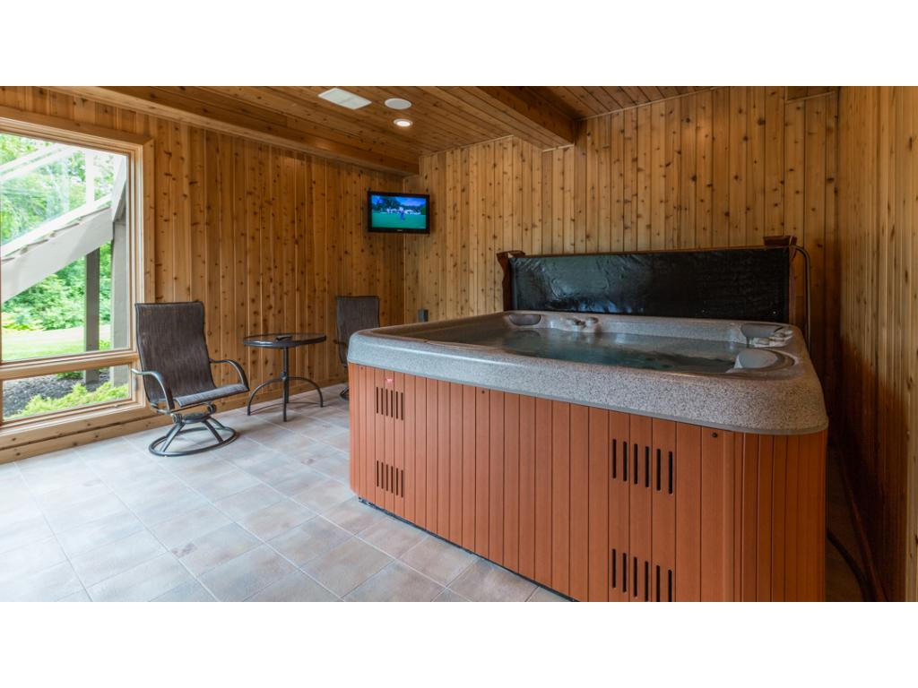 Lower level spa room is surrounded in tongue & groove paneling & offers built-in surround sound & tile flooring.