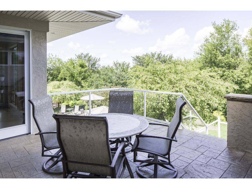 Sizeable maintenance free deck with stamped concrete flooring and glass railing for unobstructed backyard views - it's the ideal spot for outdoor BBQ's & entertaining! Home is wired for and offers a temporary generator.