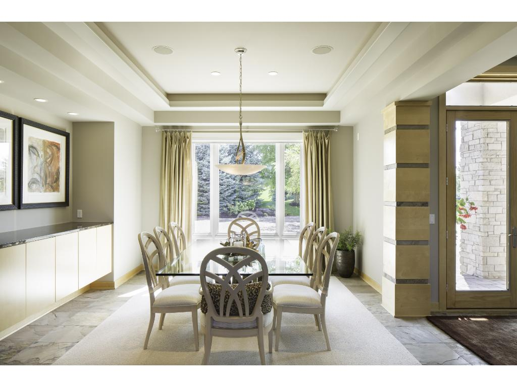 Elegant formal dining room offers a convenient butler's pantry with granite countertop and a charming buffet nook. The space is illuminated by an elegant chandelier and step up ceiling, creating a delightful ambience for entertaining!