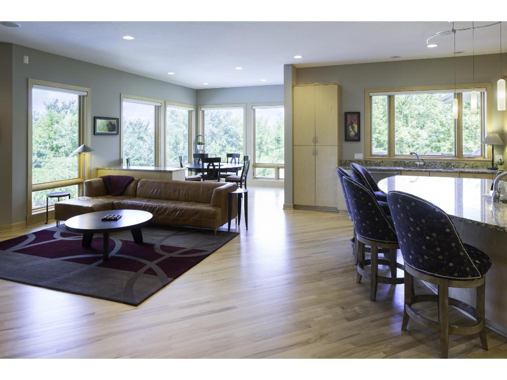 Main level sitting room features a cozy gas fplc. Nearby is the informal dining area offering splendid backyard views & sliding glass door providing access to the deck! Built-in surround sound speakers can be found thru-out the home & outside.