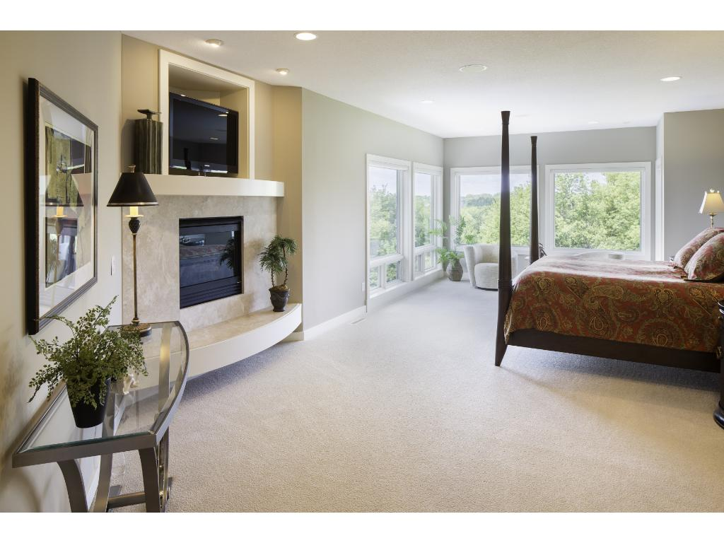 Exquisite master suite is a peaceful haven! Details include a quiet sitting area & gas fplc. 9'-10' ceilings & 8' doors found thru-out. You will observe designer light fixtures, custom window treatments & overflowing architectural details thru-out!