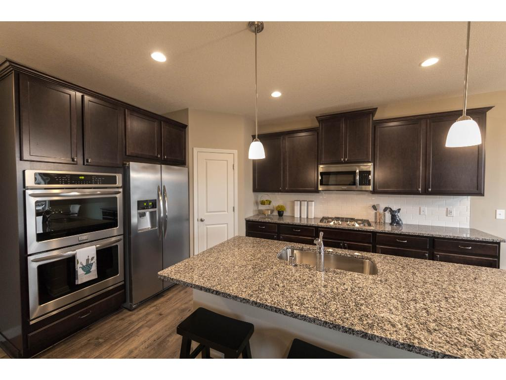 Rich Espresso Stained Maple Cabinetry, Granite, Subway Tile Back Splash,  Built In