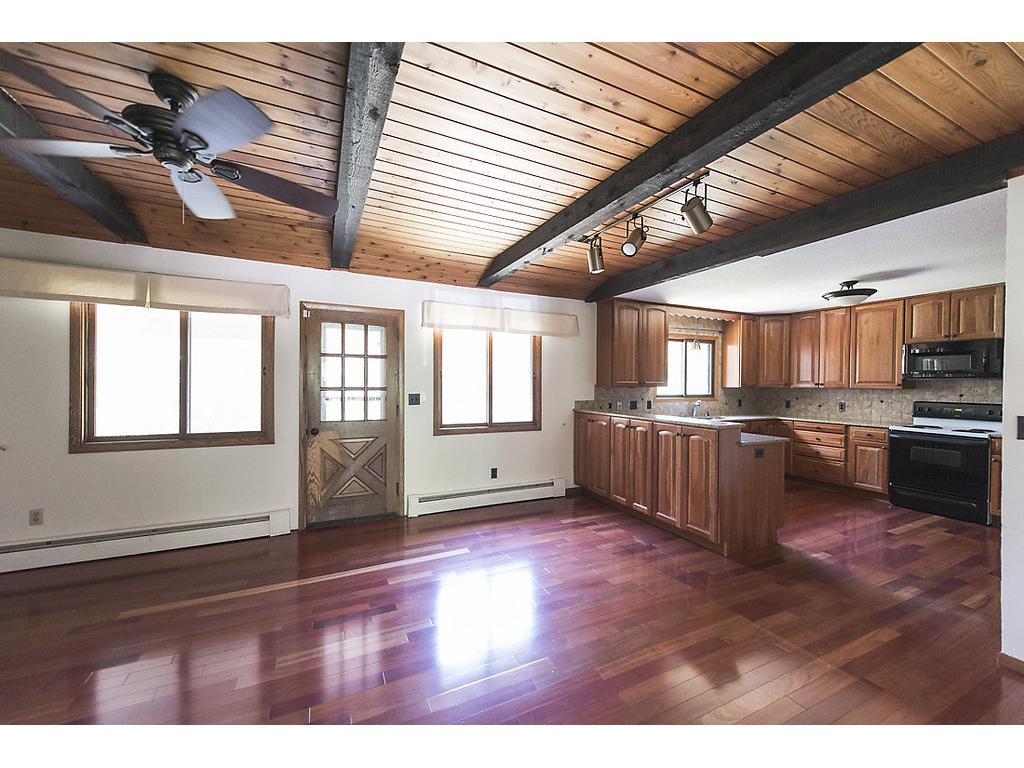 Check out the size of this main level family room!  Walk out to screened in porch and dining area - excellent view - huge lot!