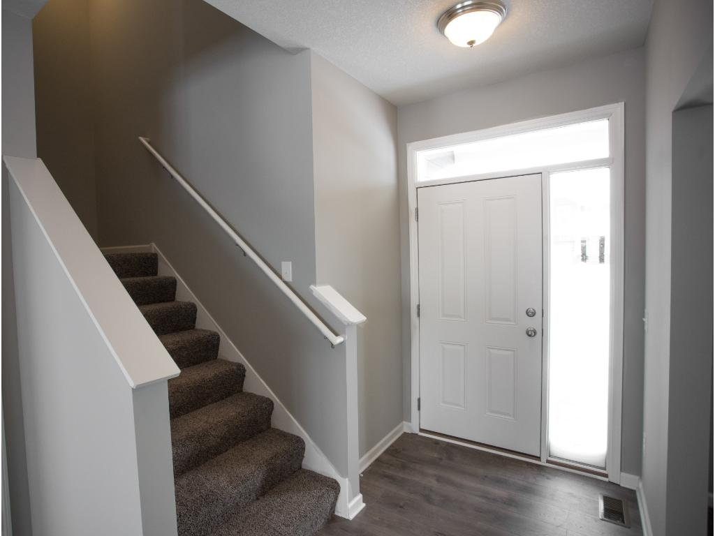 """Color palate selected for this home.White cabinets, trim and doors make for a bright and fresh look. On trend 5"""" wide plank flooring and much more!"""