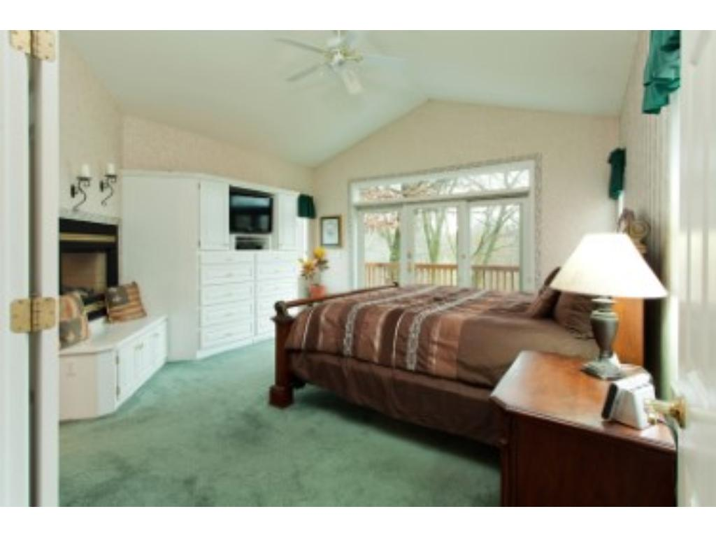 vaulted master bedroom with it's own deck