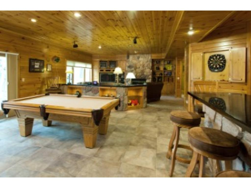 incredible lower level family room, with wood burning fireplace
