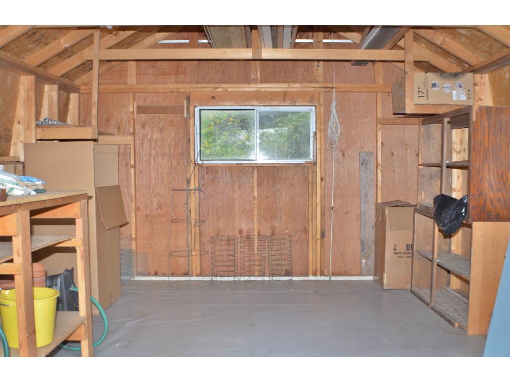 Additional storage shed for all of your mowers, rakes, or trimmers with built in shelving.