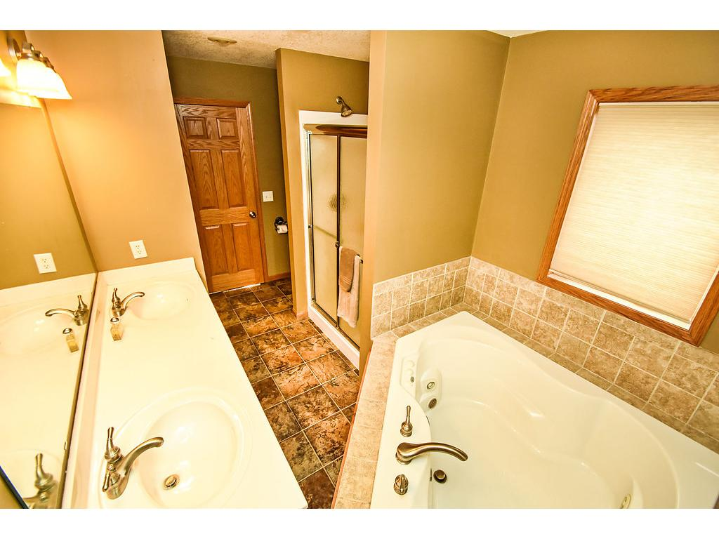 Master bathroom has a double sink vanity, separate shower and jetted tub.