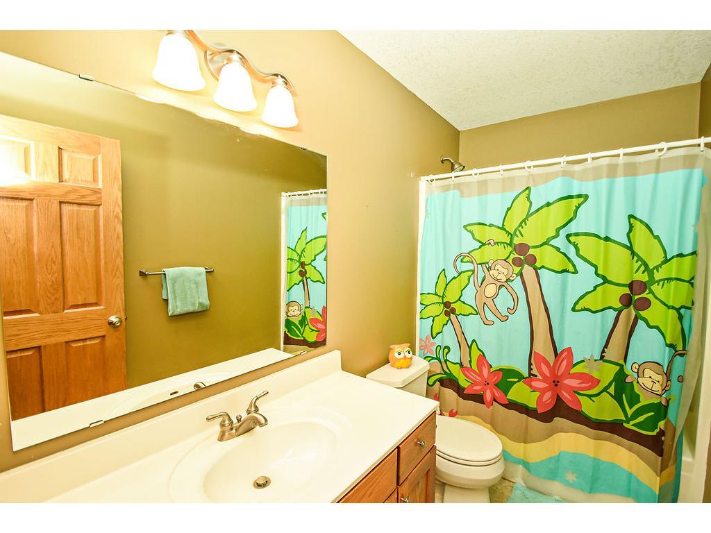 Upper level main bath has a tub/shower.